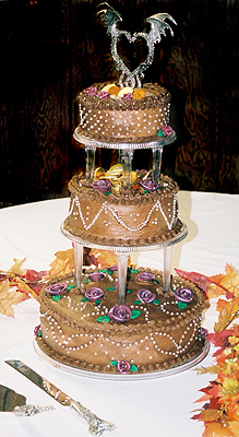 Chocolate iced wedding cake with transparent separator columns