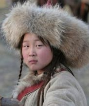 Child actor Oduren in Mongolian fur hat.