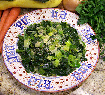 Cooked greens and chopped leeks sprinkled with breadcrumbs