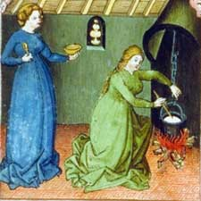 women cooking over fire